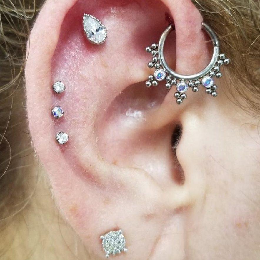 Ear piercing by Jen Minuti