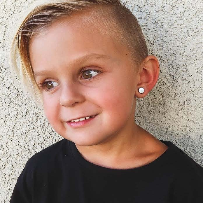 Photo of a boy with an ear piercing
